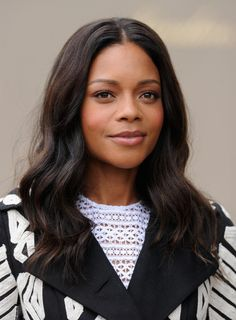 Best Celebrity Beauty Looks This Week  - Naomie Harris at the Burberry show wearing natural makeup and flawless waves