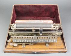 Lot 260, A Victorian Merritt typewriter contained in an oak case, est £100-150