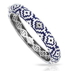 Belle Étoile Aztec White and Blue Bangle- Like the beautiful patterns and designs found in early ancient Aztec art, the Aztec Collection plays with intricate geometric shapes and repeating patterns. Rich delicate sterling silver panels are each individually hand-painted with beautiful Italian enamels and pavé-set white stones. The Aztec Collection is a truly remarkable accent to your look.