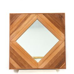 This mirror is featured in a solid wood. This bohemian style wall mirror has a diamond shaped mirror and wire for hanging on the back. Stylish mirror that's perfect for a vanity wall! #bohemian #decor #mirror #sandiegovintage #vintagefurniture