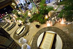 Rustic Pacific Northwest forrest inspired ferns, moss, river rock and candle centerpiece