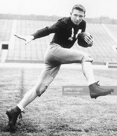 John Lattner #14 of the University of Notre Dame Fighting Irish poses for a…