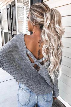 Make the messy high ponytail your winter savior