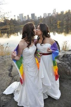 A lesbian couple marriage. They are wrapped in a gay pride flag to express their sexuality. Cute Lesbian Couples, Lesbian Pride, Lgbt Wedding, Lesbian Wedding Photos, Wedding Shot, Wedding Beach, Spring Wedding, Wedding Engagement, Wedding Ceremony
