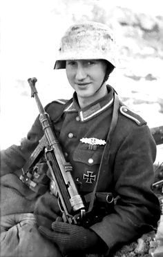 Portrait of a young Wehrmacht Unteroffizier, who was awarded both the Close Combat Clasp (German: Nahkampfspange) and the Eastern Front Medal, with his MP-40 machine gun during the Battle of the Korsun-Cherkassy Pocket of the Dnieper-Carpathian Offensive. The Dnieper-Carpathian Offensive, fought from 24 December 1943 until 14 April 1944, was a successful strategic offensive executed by the 1st, 2nd, 3rd and 4th Ukrainian Fronts, along with the 1st Belorussian Front, against the German Army…