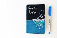 Moleskine journal with a polar bear on an iceberg by LaDouceurDuMiel