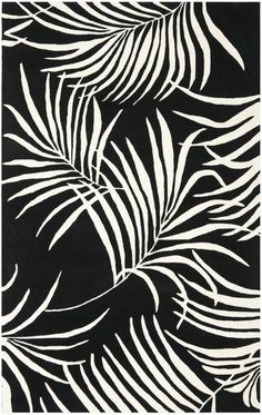 Black and white area rugs with palm leaf pattern. The Safavieh Soho SOH778B Black and Ivory