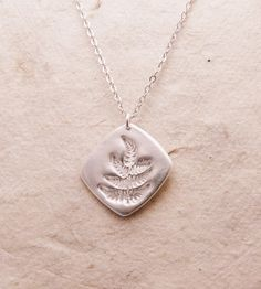Silver Fern Necklace | Sculpted in pure silver, this handmade necklace features a del... | Necklaces
