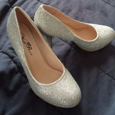 HP  Silver Platform Pumps Super sparkly silver shoes. Worn only once, they're in perfect condition. Wild Rose Shoes Heels