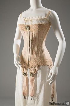 """Corset and chemise, circa From the Collection of The Museum at FIT / Early twentieth-century corsets rested low on the bosom, and extended over the hips. When laced, the so-called """"straight-front"""" corset provided an """"S curve"""" that pushed the. Corset Vintage, Lingerie Vintage, Vintage Underwear, 1900s Fashion, Edwardian Fashion, Vintage Fashion, Edwardian Era, Ny Fashion Week, Vintage Mode"""