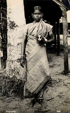 An amazingly clean postcard image listed as Tamil Girl, found on ebay last week. The designs on her saree pallu are wonderful. She does appear to be holding a very young puppy, and wears lots of ear jewellery. Just a great photograph from around the 1920s or so.