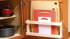 Store cutting boards in your cupboards with a magazine rack On Tap @O N Tap #Organisation #Kitchens