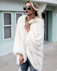 We love the soft texture of our Get The Luxe Faux Fur Cardigan! This outerwear takes it to the next level with it's shaggy appeal in ivory. The relaxed fit of i