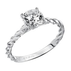 Solitaire diamond engagement ring featuring a delicate rope design by ArtCarved Bridal.