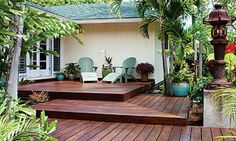 Instead of stairs, a three-level deck steps up to the front door of this raised post-and-pier house on Oahu.