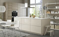 Bright VOXTORP IKEA kitchen with highgloss beige cabinets, stainless steel appliances and walnut effect Beige Kitchen, Kitchen Sets, New Kitchen, Kitchen Small, Kitchen Cabinets Fronts, Beige Cabinets, Moveable Kitchen Island, Large Kitchen Island, Kitchen Islands
