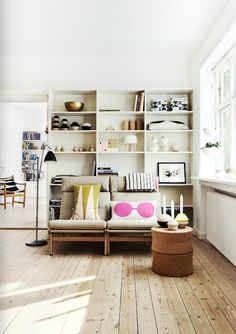 Love the shelves & the quirky pillows.  Living room inspiration.