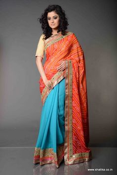Tanushree Half-Half Style Pure Bandhej Saree: In a flamboyant combination of bright blue and rich red with coruscating bandhej print with gota patti and contrasting patch border, Tanushree Half-Half Style Bandhej Saree is trendy and is here to set the ball rolling for Jaipuri Bandhej Sarees.