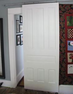 EAK! A House!: DIY Sliding Door - FAVE LOOK SO FAR, VERY DISCREET, BUT SHE'S NOT HAPPY WITH IT.