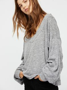 Lucky Charm Pullover   Ultra soft pullover featuring a femme update with scrunched details along the sleeves.  * Subtle side vents * Scooped neckline