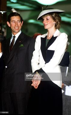 The Prince and Princess of Wales visiting a department store in Tokyo, Japan, May 1986. Princess Diana is wearing a suit by Catherine Walker.