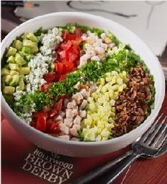 """""""Our Famous Cobb Salad"""" with Finely Chopped Greens, Turkey Breast, Bacon, Egg, Tomatoes, Crumbled Blue Cheese, Avocado, Chives, and Cobb Dressing"""