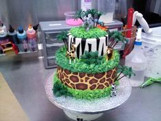Jungle Theme Baby Shower Cake: This cake was made for my son's friends baby shower.  They wanted something with a jungle theme and this is what I came up with.  Editor's Note: That's