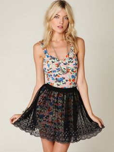 Cute layering idea: circle skirt over a fitted dress.