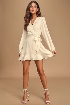 All you need for a perfect night is the Lulus Laughter and Love Cream Long Sleeve Faux-Wrap Mini Dress! A flirty faux-wrap mini dress with long sleeves. Formal Dresses With Sleeves, Trendy Dresses, Cute Dresses, Casual Dresses, Short Dresses, Wrap Dresses, Womens Formal Dresses, Formal Wear Women, Wedding Dress Tea Length