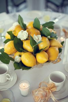 This would be really easy to do. Just toss some lemons and leaves into a bowl and place a few flowers.