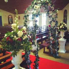 Urns, Arch and Red Carpet
