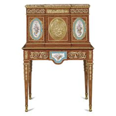 A French gilt-bronze-and porcelain-mounted ebony inlaid kingwood, tulipwood and parquetry bonheur du jour, in the Louis XVI style, circa 1870.