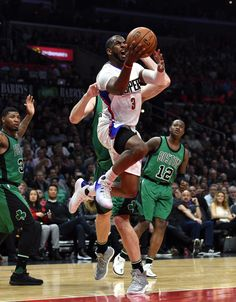 LOS ANGELES, CA - MARCH 6: Chris Paul #3 of the Los Angeles Clippers scores basket after getting fouled by Tyler Zeller #44 of the Boston Celtics during the first half of the basketball game at Staples Center March 6 2017, in Los Angeles, California. (Photo by Kevork Djansezian/Getty Images)