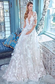 This Galia Lahav wedding dress features deep-V neckline, illusion sleeves and 3D floral appliques. Galia Lahav Le Secret Royal Couture Collection