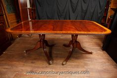 http://canonburyantiques.com/s/dining-tables/regency-dining-tables/1/  Regency dining table in flame mahogany with satinwood crossbanding. Two pedestal table at it's smallest configuration with no leaves. Add two extra leaves for more size. Large range of other Regency dining tables