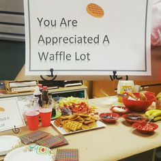 Waffle Bar for Teacher Appreciation Breakfast. Included various fruits, chocolate chips, syrup, butter, cream cheese whipped cream, juice, muffins, and bagels.