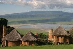 Ngorongoro Crater is one of Africa's supreme sights. Cupped within the cone of what was once a giant volcano, this grassy plain is a complete ecosystem from insects to elephants, lions, rhinos, zebras, and wildebeest. Ngorongoro Crater Lodge is perched on the edge of the world-famous Ngorongoro Crater at the Eastern edge of the Serengeti in Northern Tanzania.