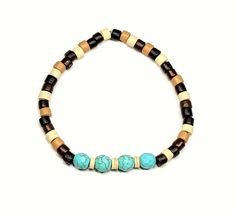 The Zia Bracelet was inspired by the cultural significance of the number 4 to many Native American peoples. The number 4 represents the 4 seasons, the 4 cardinal directions, the 4 periods of the day, the 4 stages of life, and the 4 sacred obligations. This beautiful bracelet is made with 4 turquoise beads and finished with mixed natural colored wooden beads. Definitely has a cool natural feel, perfect for anyone!  RIBBONANDSTEEL.ETSY.COM
