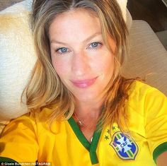 'Excited!!! Go Brazil!!!! #worldcup': Gisele Bündchen also got in on the action, posting this glamorous selfie as she watched the game while reclining on a sofa, decked out in Brazil's yellow and green jersey