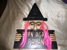 http://www.greengoddessearth.co.uk/ourshop/prod_3008741-Born-Again-Pagan.html  'Born Again Pagan' wall-art, a bit of witchy humour from Green Goddess Earth! £15.99, including postage and packaging.