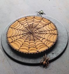 Martha Stewart's Pumpkin Chocolate-Spiderweb Tart: The chocolate crust is filled with creamy pumpkin puree blended with familiar pie flavorings like cinnamon, ginger, and nutmeg. Although unexpected, pumpkin and chocolate make a blissful pair. Comida De Halloween Ideas, Menu Halloween, Halloween Torte, Bolo Halloween, Pasteles Halloween, Dessert Halloween, Holidays Halloween, Halloween Treats, Happy Halloween