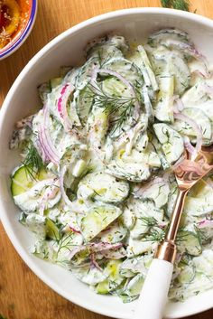 Greek cucumber salad with marinated red onions tossed in a tzatziki inspired Greek yogurt dressing. It's the best tasting cucumber salad. Cucumber Recipes, Salad Recipes, Yogurt Recipes, How To Make Salad, Food To Make, Tzatziki, Greek Cucumber Salad, Cucumber Salad Vinegar, Greek Yogurt Dressing