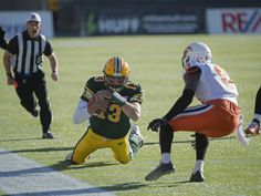 Quarterback Mike Reilly of the Edmonton Eskimos, runs out the clock late in the third quarter against of the BC Lions at Commonwealth Stadium in Edmonton. Shaughn Butts/Edmonton Journal