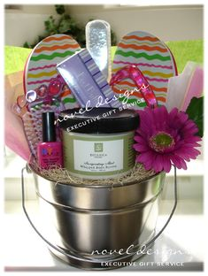 Novel Designs Executive Gift Service, Las Vegas premier gift baskets, Custom Sweet Feet Gift Basket.  Great Mothers Day, Christmas & Birthday Gift.  Contains all the pedicure necessities... right down to the polish!  Contact us today to find out more about custom designing the Sweet Feet Gift Basket!