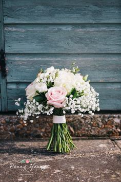 Pretty pastel wedding bouquet. Church wedding. Spring wedding reception at The Great Barn in Rolvenden Kent. Rustic barn wedding. Photography by Penny Young Photography.