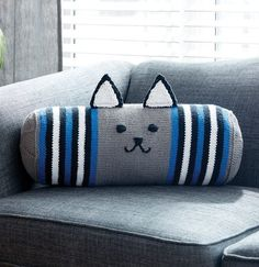 Free Knitting Pattern for Kitty Bolster Pillow - Adorable cat-faced cushion from Yarnspirations. Approx 19″ [48 cm] long x 7″ [18cm] diameter.