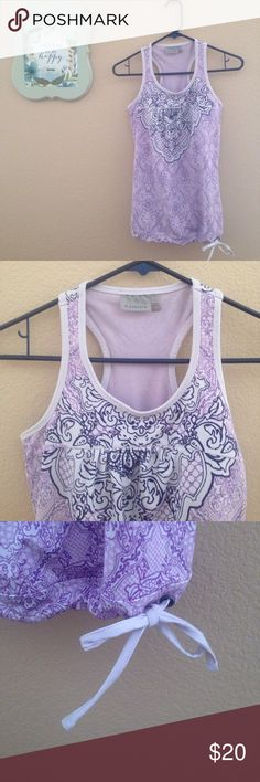 Athleta Racerback Top This tank from Athleta is super cute! It is in excellent condition and has a built-in-bra. The bottom as an adjustable tie so it will stay securely in place. Athleta Tops Tank Tops