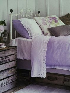 A delicate bed and linens, combined w/a simple crate as a side table. It's just the right height, too.