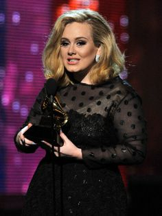 Photo d'actualité: Singer Adele accepts the award for Song of…