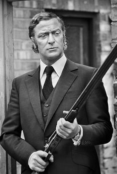 Michael Caine in Get Carter sporting bespoke by Dougie Hayward. Classic.